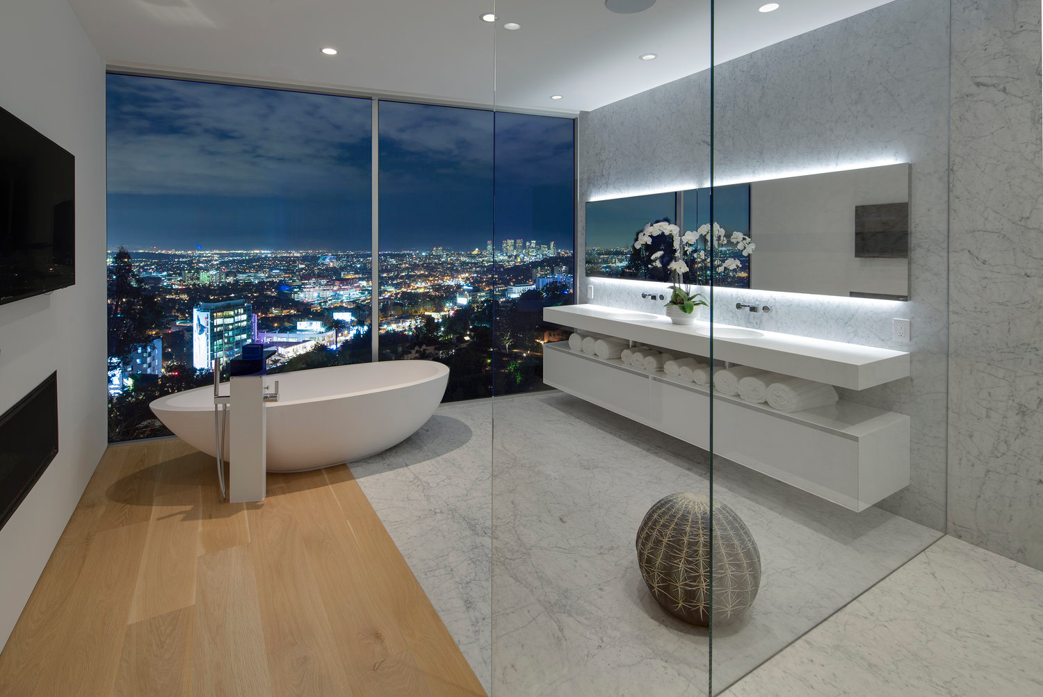wall to wall glass enclosed bathroom