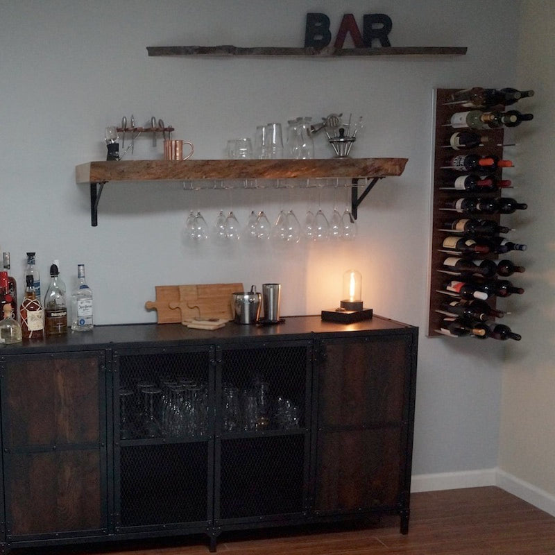 home bar with stemware and bottle storage racking
