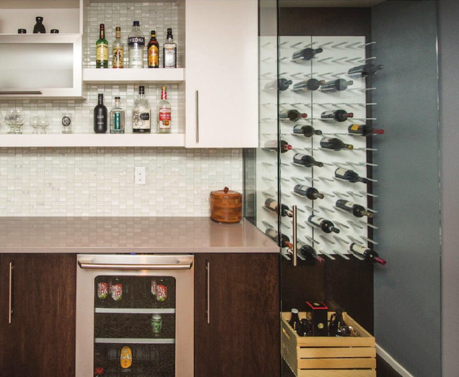home bar with glass walled wine cellar