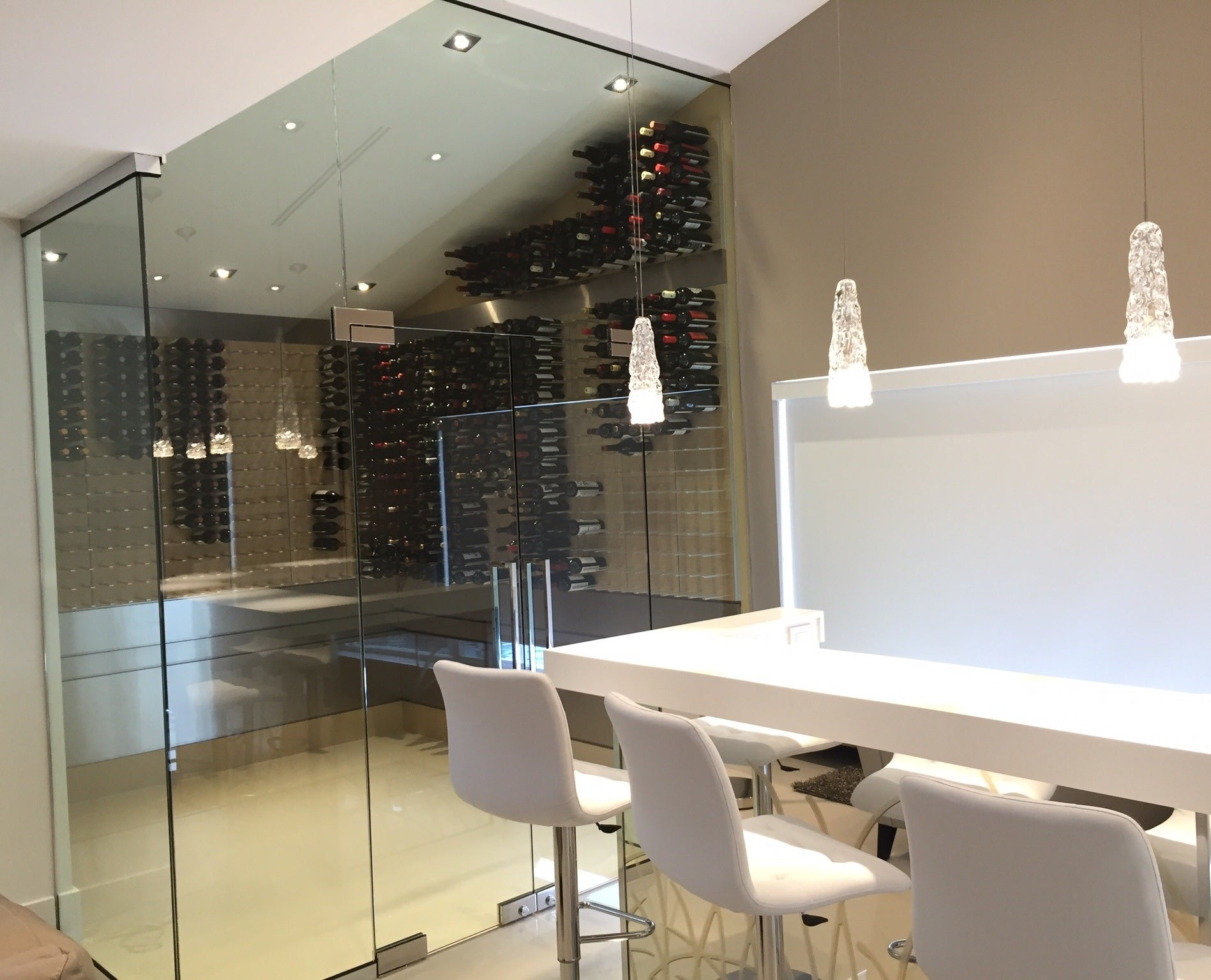 luxury home bar with tasting room and glass enclosed wine cellar