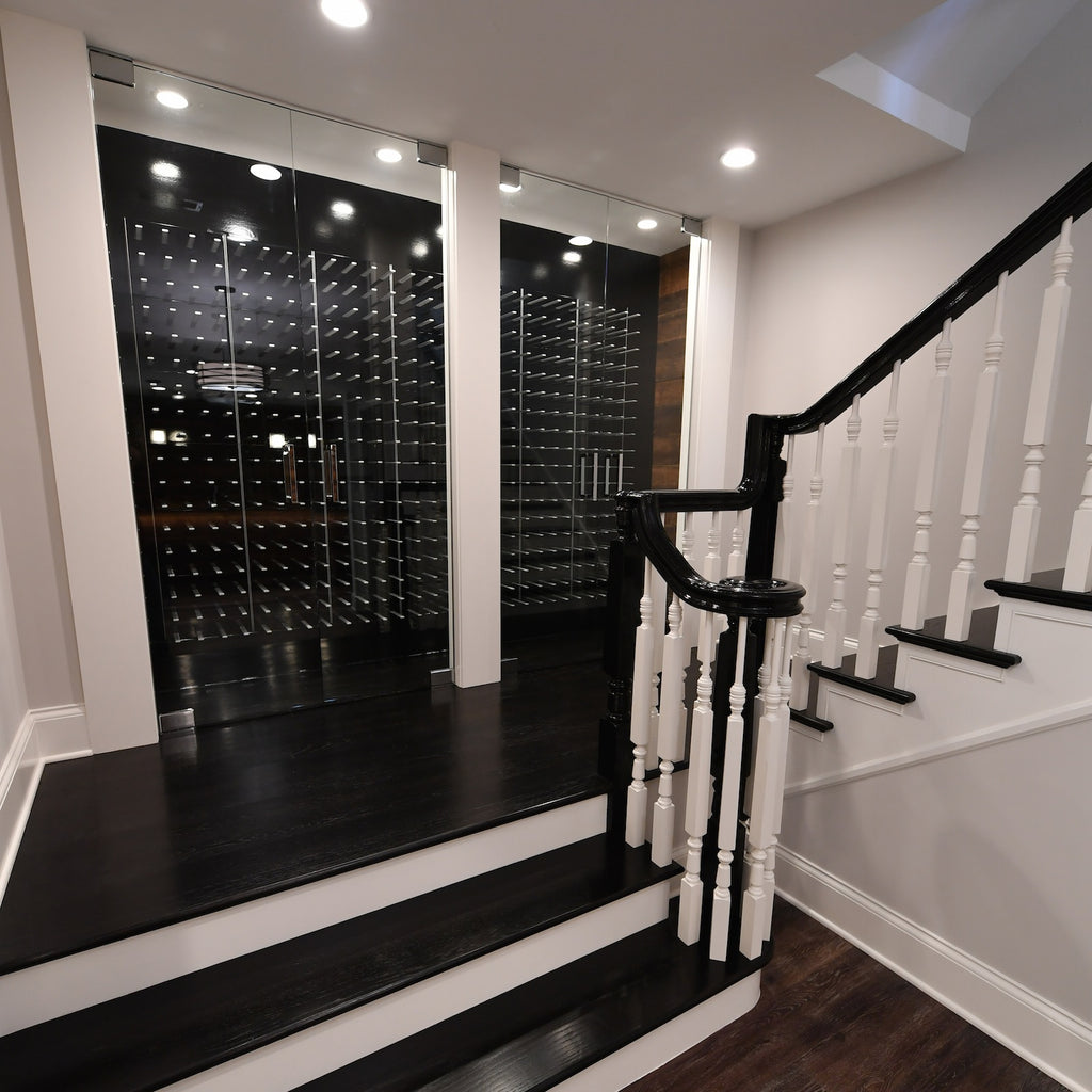 high gloss black wine cellar in glass enclosure