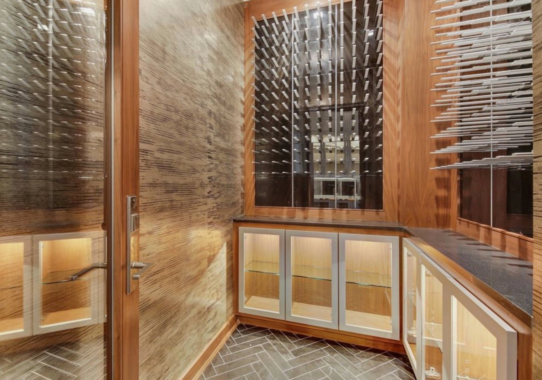 transitional wine cellar design with peg wine racks