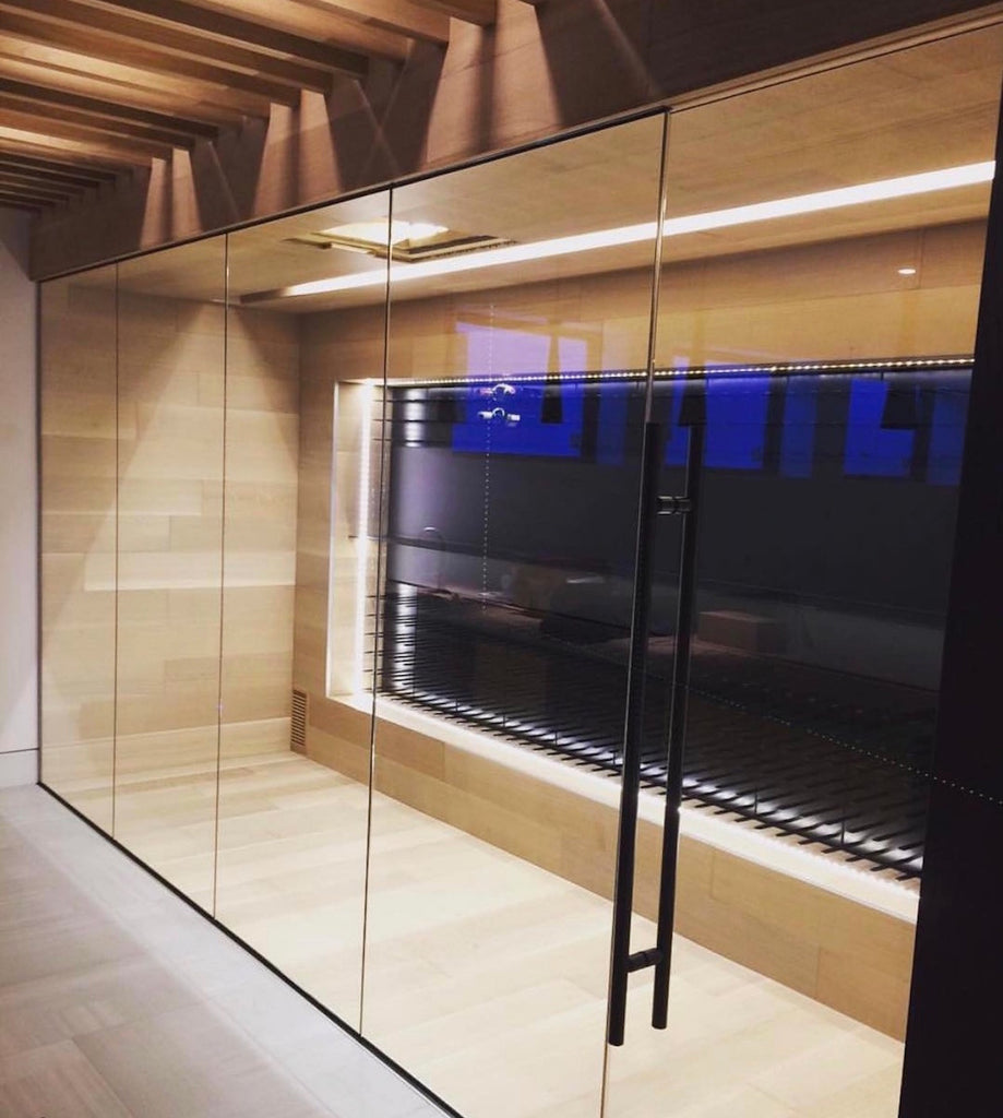 modern frameless glass wine cellar design