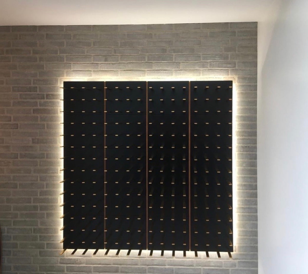 wine cellar with black panels / gold pegs