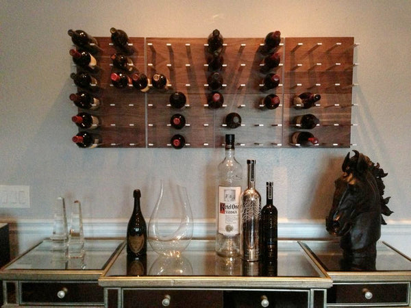 STACT wine racks above a bar in this home