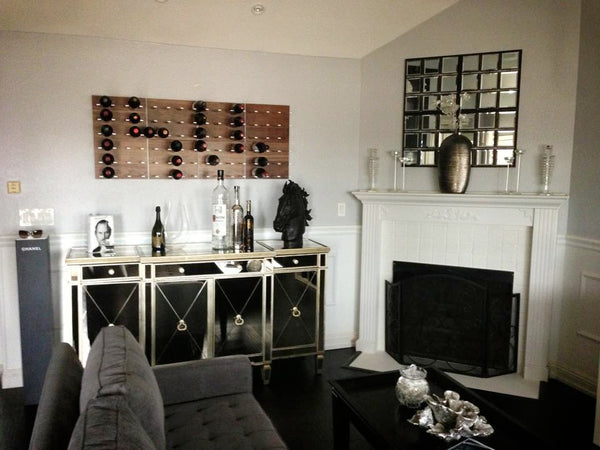 STACT wine racks near a fireplace, heritage decor