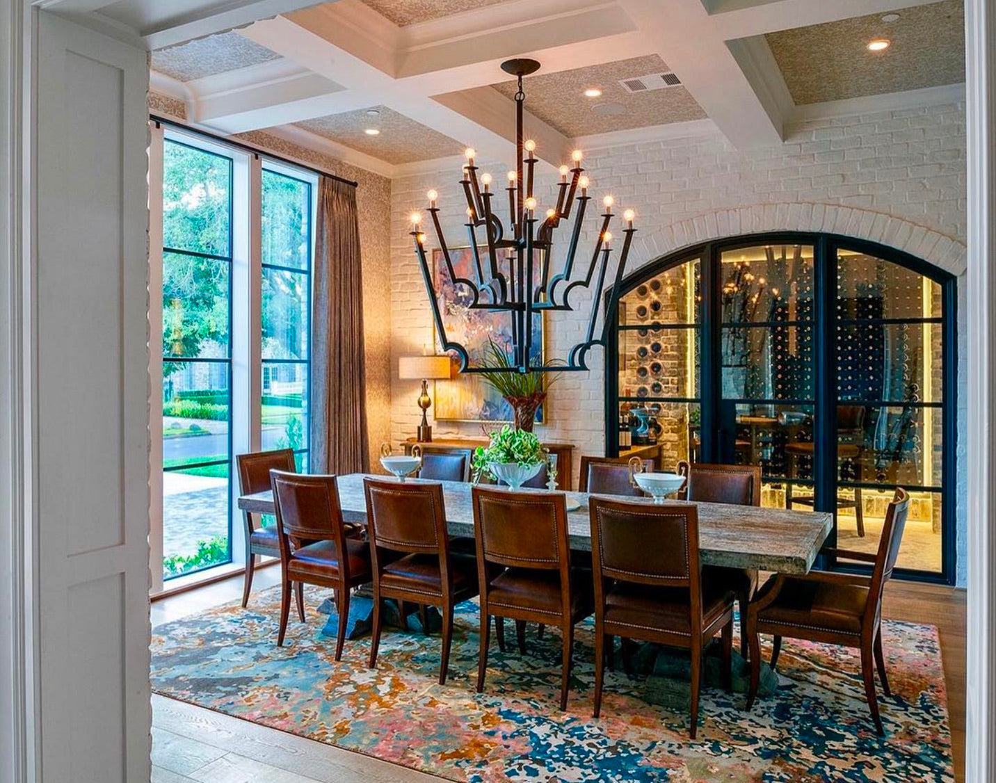 transitional custom wine cellar with arched glass doors - houston tx