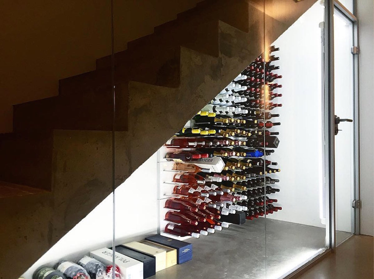 under stairs glass wine cellar concrete villa