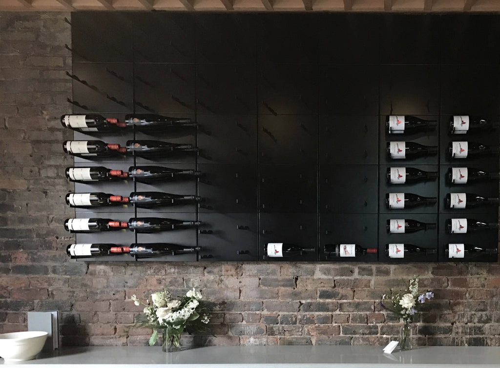 label-out wine racks mounted on bricks