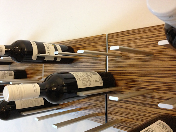 wine rack in exotic zebrawood via WSJ