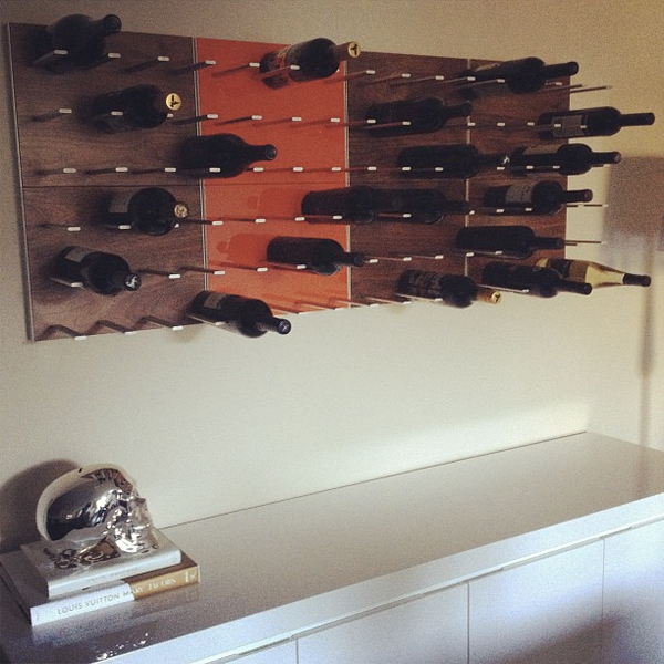 wall-mounted wine rack in vancouver - walnut and orange