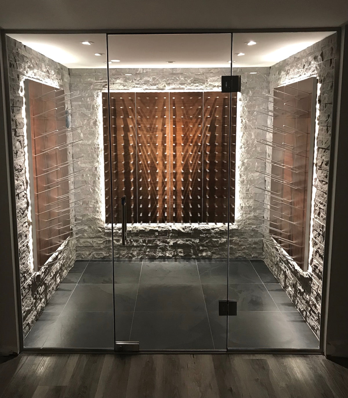floor to ceiling glass wall wine cellar