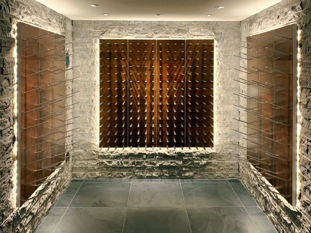 wine room with peg racking on stacked stone