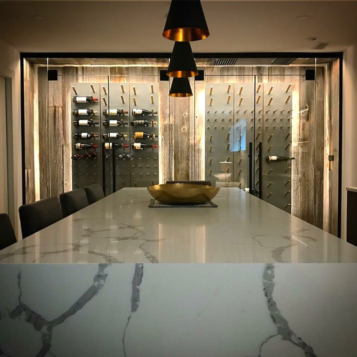 marble, concrete, glass and gold wine room