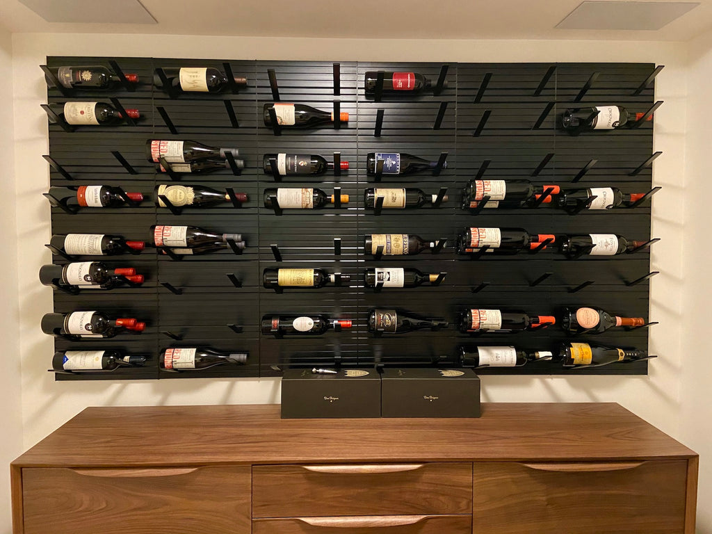 label forward wine racks - black metal wall display