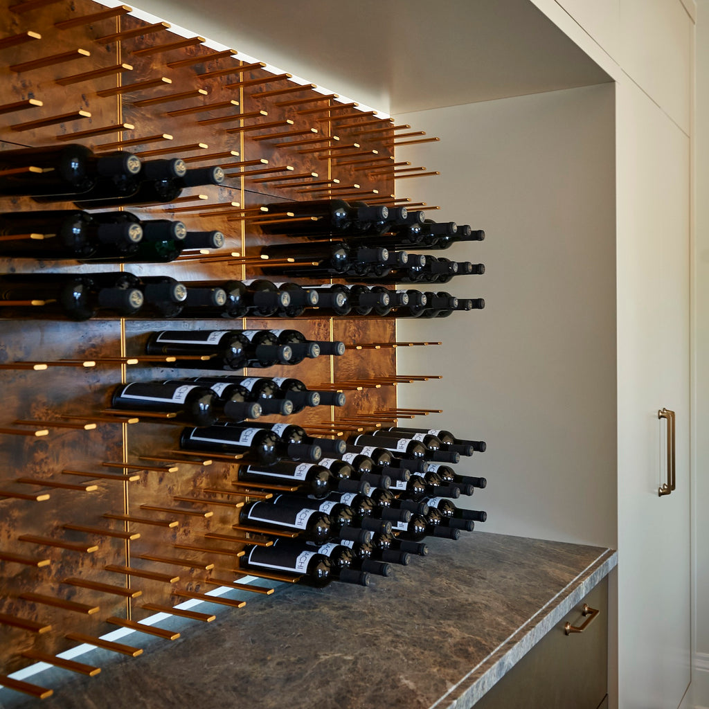 built-in wood wine nook with gold pegs
