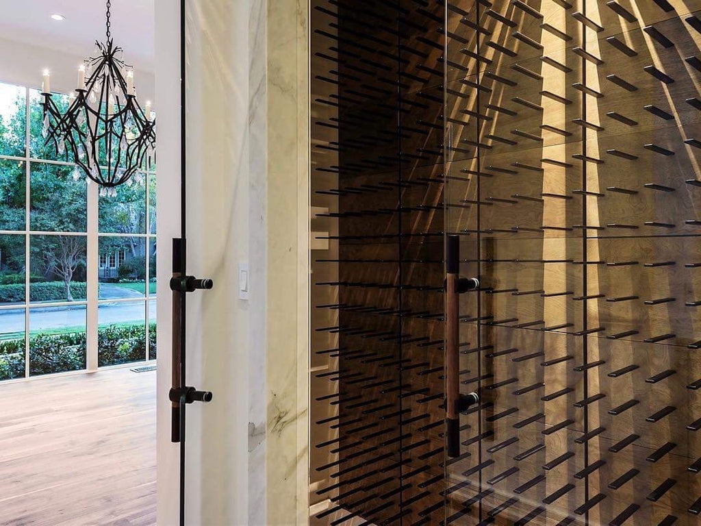 transitional wine cellar design with glass enclosure