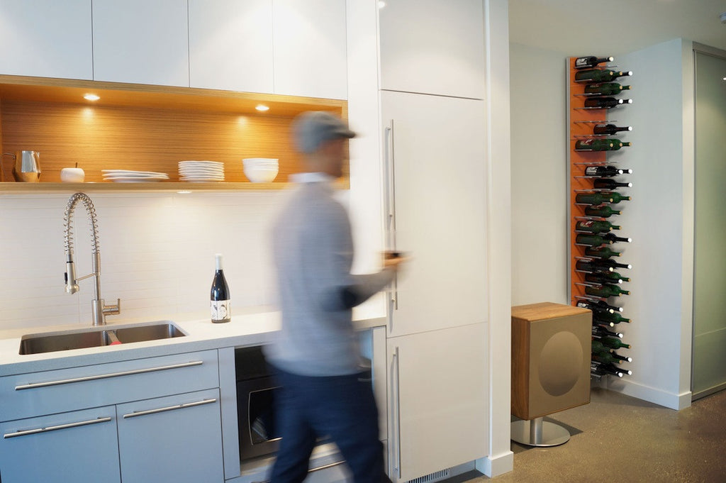 floor-to-ceiling modular wine wall - electric orange lacquer