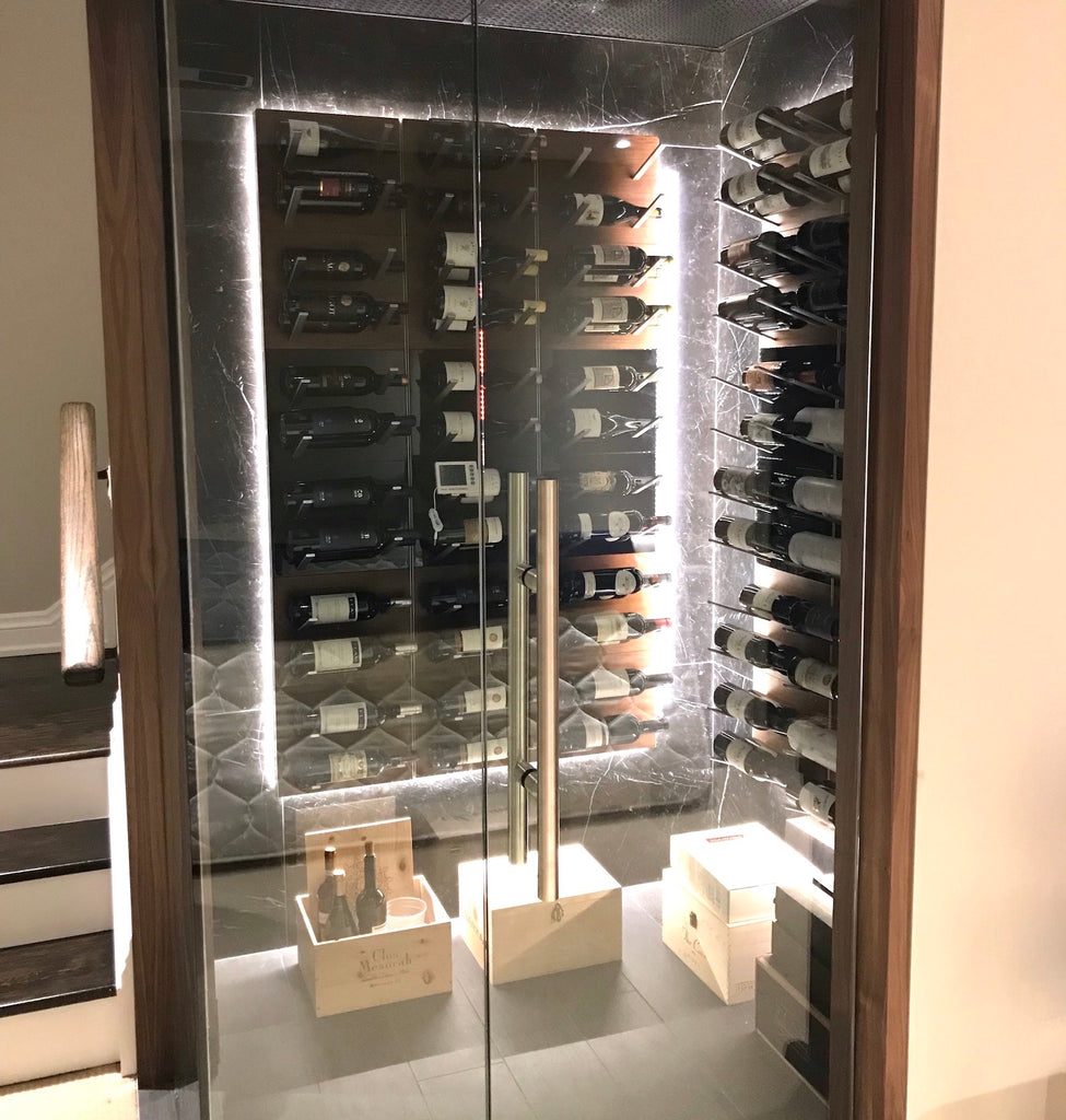 label-out wine display racking in glass-enclosed wine cellar