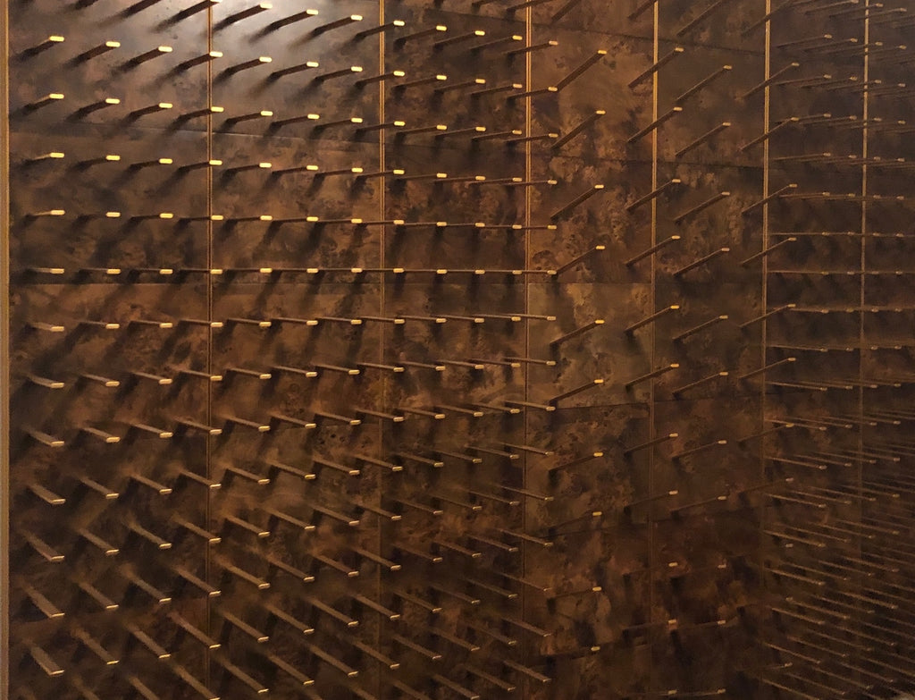 burled wood wine wall panels and pegs