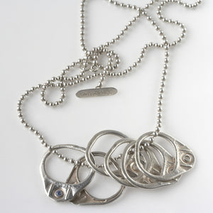 Six Pack Necklace is Six Old School Pull Tabs in Silver by Laura Lobdell