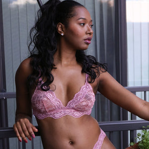 Model wearing the Fantasia Lace Bralette in Bellini Pink