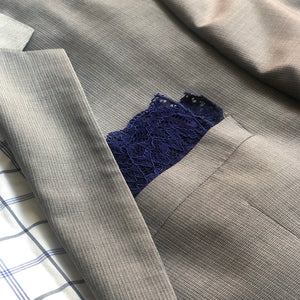 Duchess lace pocket square in Venetian blue on grey suit.