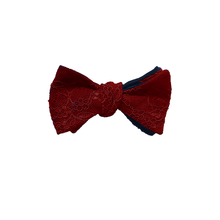 "Load image into Gallery viewer, Fantasia lace bow tie with passion red lace, self tie, and adjustable from 13 1/4"" to 18""."