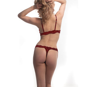 Model wearing fantasia lace bralette and thong from behind.