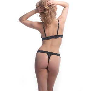 Model facing away wearing the Fantasia Lace Thong and Bralette.