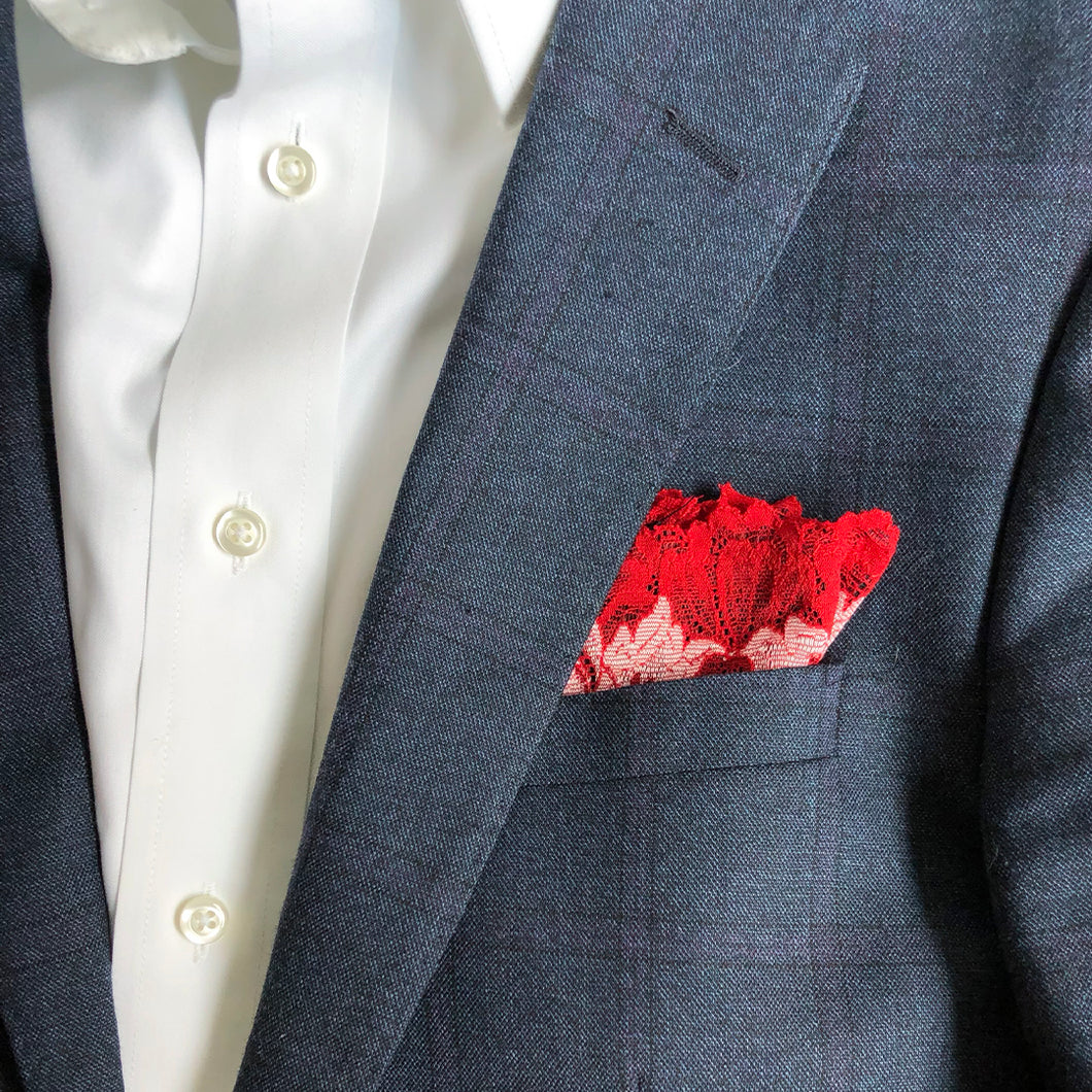 Mezzanotte pocket square in Passion Red folded into lapel pocket.