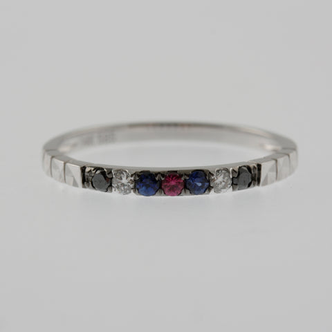 Black and white diamond, ruby and sapphire white gold ring band