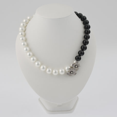Black and white shell necklace with sterling silver handmade flower accents