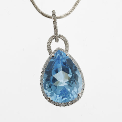 Blue topaz and diamond pendant 18ct white gold