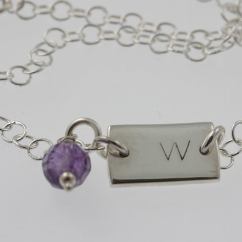 Personalised jewellery: initials and charm on a bracelet or necklace