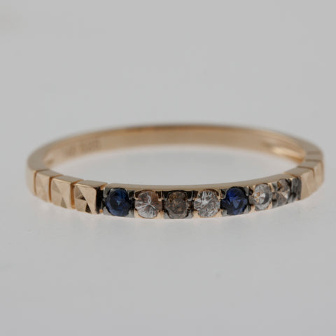 Brown and white diamonds with blue and white sapphires in a rose gold ring band
