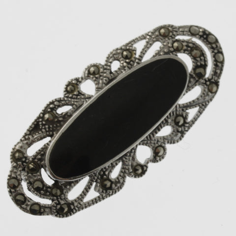 Cabachon onyx and marcasite brooch