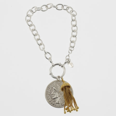 Coin bracelet on belcher chain with reproduction coin and tassle
