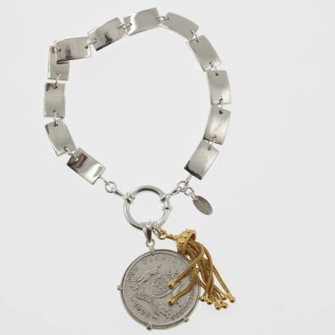 Coin bracelet on curved rectangle chain with florin and tassle