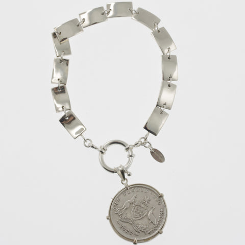 Coin bracelet on curved rectangle chain with florin