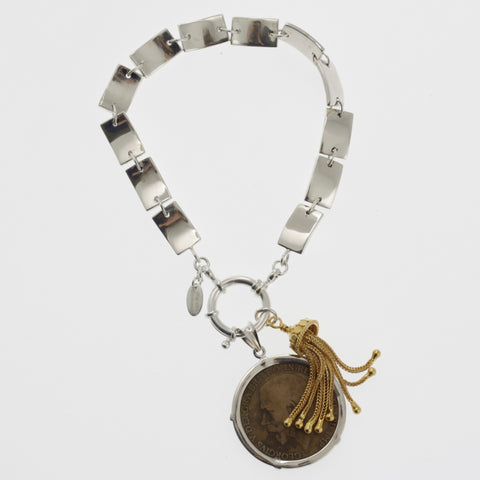 Coin bracelet on curved rectangle chain with penny and tassle