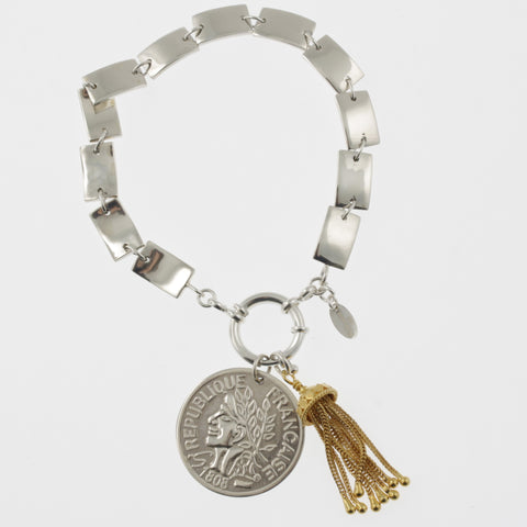 Coin bracelet on curved rectangle chain with reproduction coin and tassle