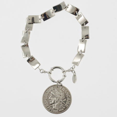 Coin bracelet on curved rectangle chain with reproduction coin