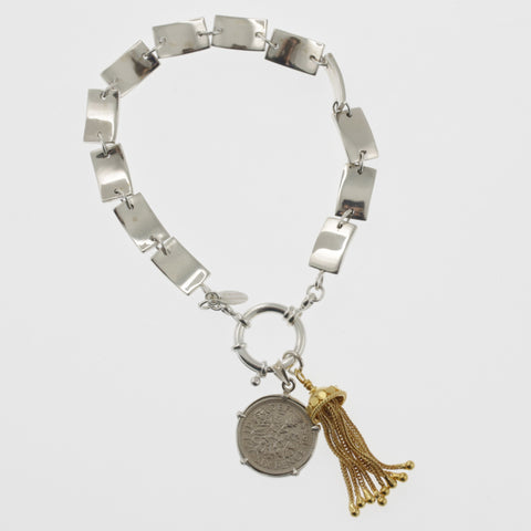 Coin bracelet on curved rectangle chain with sixpence and tassle