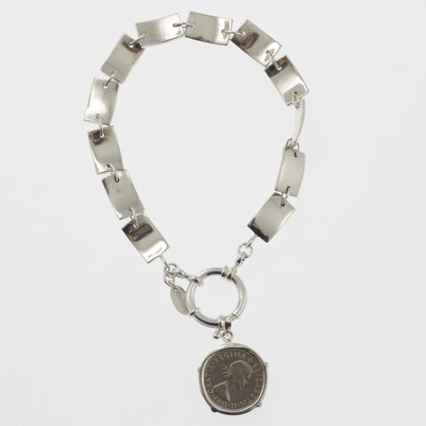 Coin bracelet on curved rectangle chain with sixpence