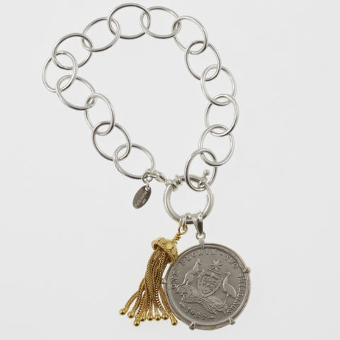 Coin bracelet on oval link chain with florin with tassle