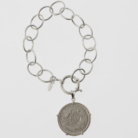 Coin bracelet on oval link chain with florin