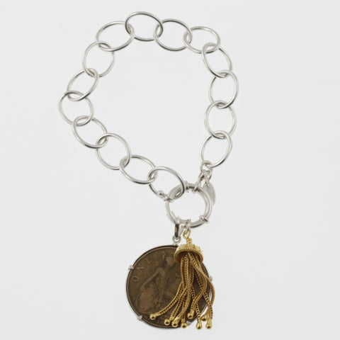 Coin bracelet on oval link chain with penny with tassle