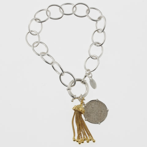 Coin bracelet on oval link chain with sixpence and gold plated tassle
