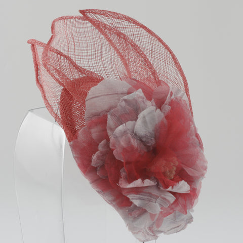 Coral and silver sinnamay fascinator